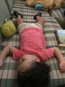 a baby sleeps on her back